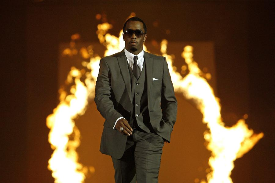 Sean-P-Diddy-Combs-walks-on-stage-at-the-end-of-the-Sean-Jean-fashion-show-duri